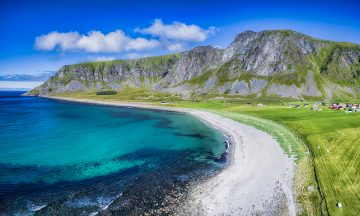 Scenic aerial panorama of beach in Unstad, one of the best beaches on Lofoten islands in Norway, famous surfing spot