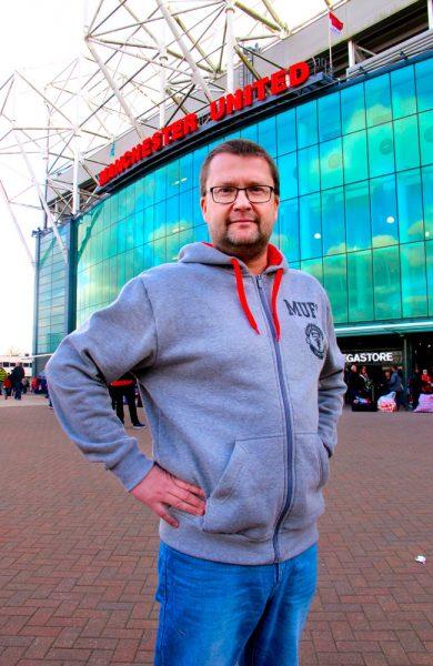 Bernt Hjørnevik fra Odda har Manchester United som fast jobb. Den daglige lederen i klubbens norske supporterklubb har reist til Manchester på fotballtur siden 80-tallet, og gleder seg over at byen også er mer enn bare fotball. Foto: Runar Larsen